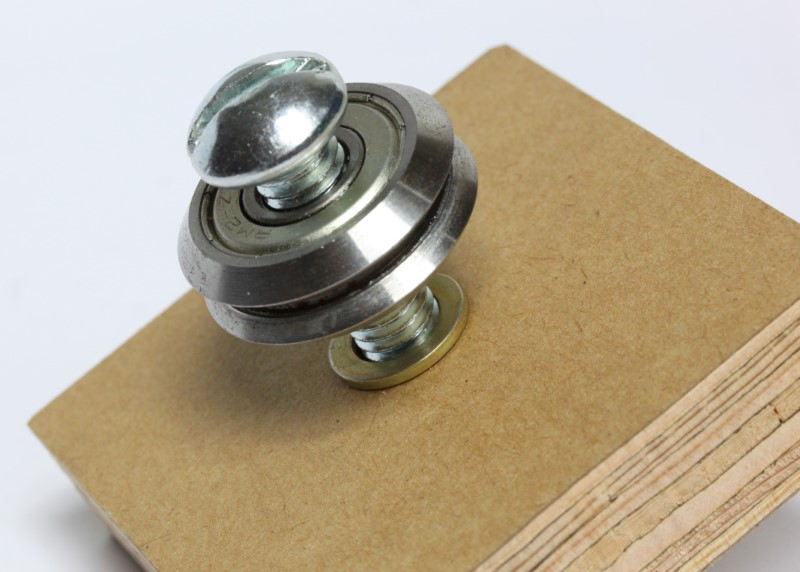 3/8 inch shim washer shown between bearing and a piece of wood.