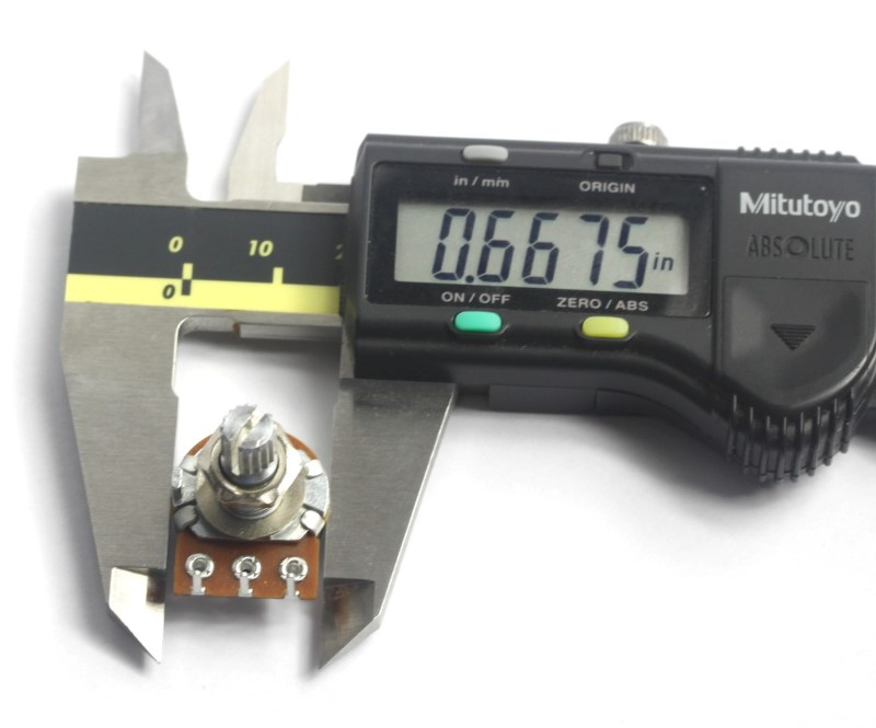 A picture showing a caliper measuring a 5k rotary potentiometer .6675 inches