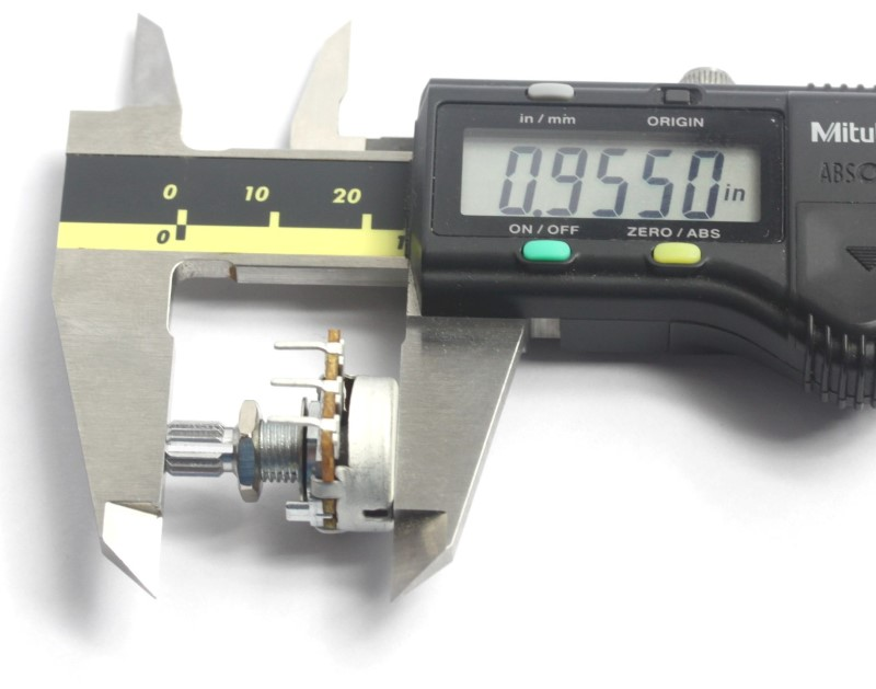 A caliper holding a 5K potentiometer showing a measurement of .9550 inches.