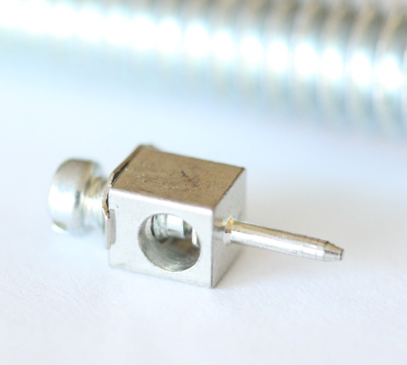 Mini binding post with tin contact looking at the back of the screw terminal