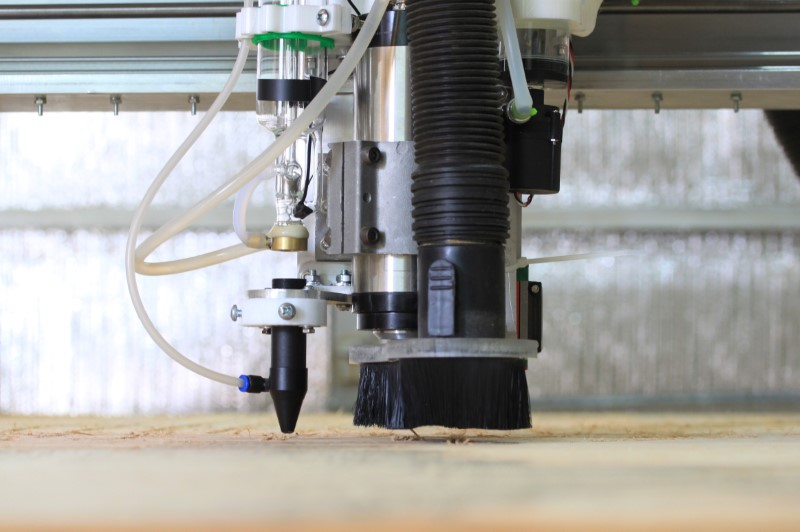 Fabricator Pro CNC Router machine view of the z axis lower part with the CO2 laser nozzle, spindle and the dust shoe
