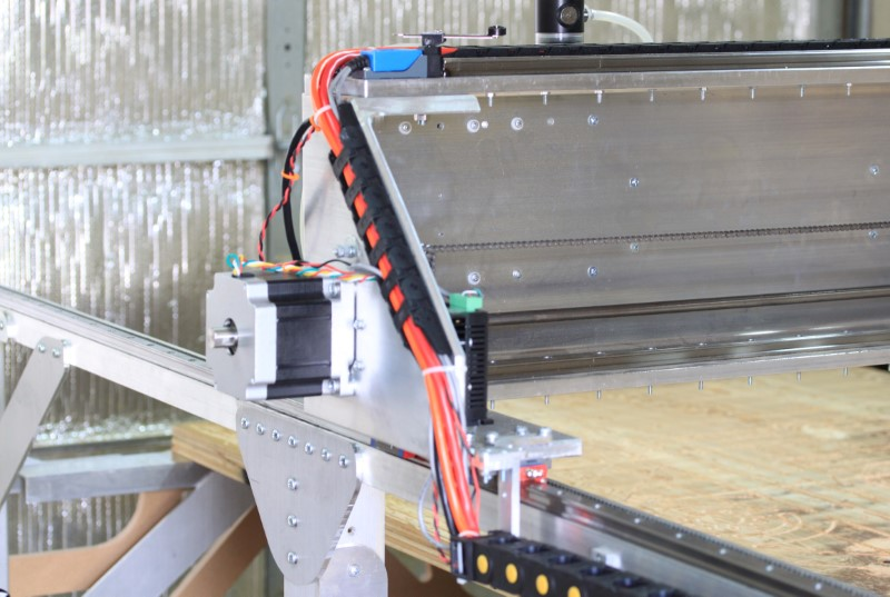 Fabricator Pro CNC Machine view of the left gantry stepper motor side with the cable carrier and cable management