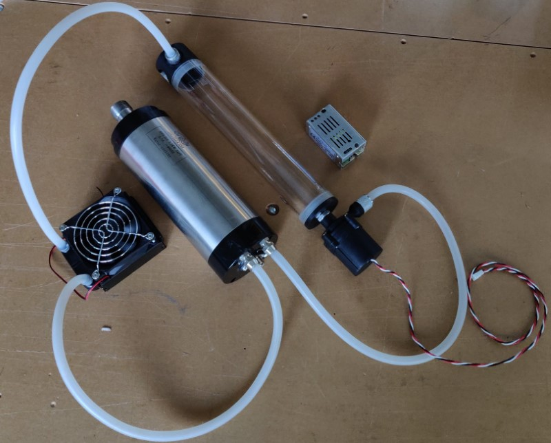 The pump, water reservoir, fan, radiator, G1/4 fittings and silicone tubing for CNC router spindle water cooling and CPU Cooling kit all connected using silicone tubing with 1/4