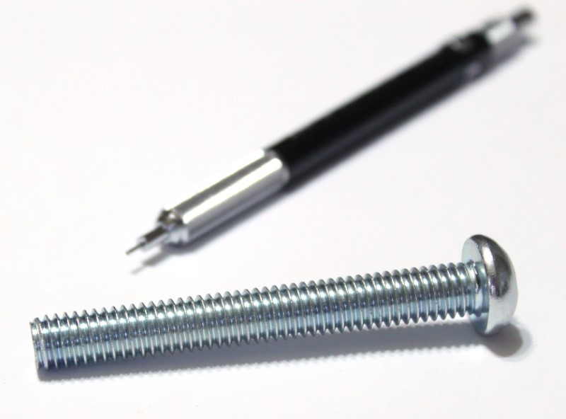 3/8 inch x 3 inch machine screw shown with mechanical pencil for scale