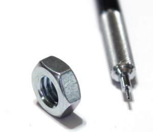 3/8 inch machine nut shown with mechanical pencil for scale