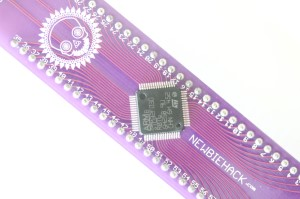 Close-up of the stm32 microcontroller soldered to the breadboard interface board