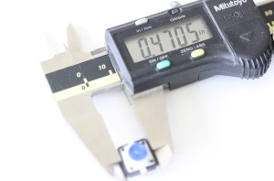 LED button shown with a caliper. The measurement reads .4705 inches.
