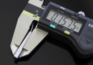 Temperature Sensor shown with a caliper. The measurement reads .1575 inches.