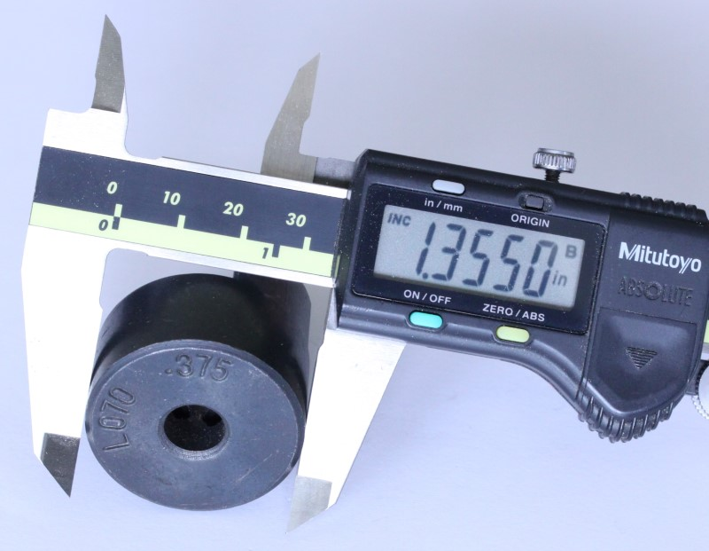 three eighths inch coupling hub shown with a caliper. The measurement reads 1.355 inches.