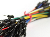 Thumbnail: A bundle of 65 jumper wires of various length and color. Bound together with the male connectors shown in the foreground.