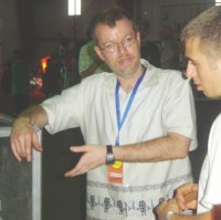 Andy Payne talking with one of the Maker Faire's attendees.